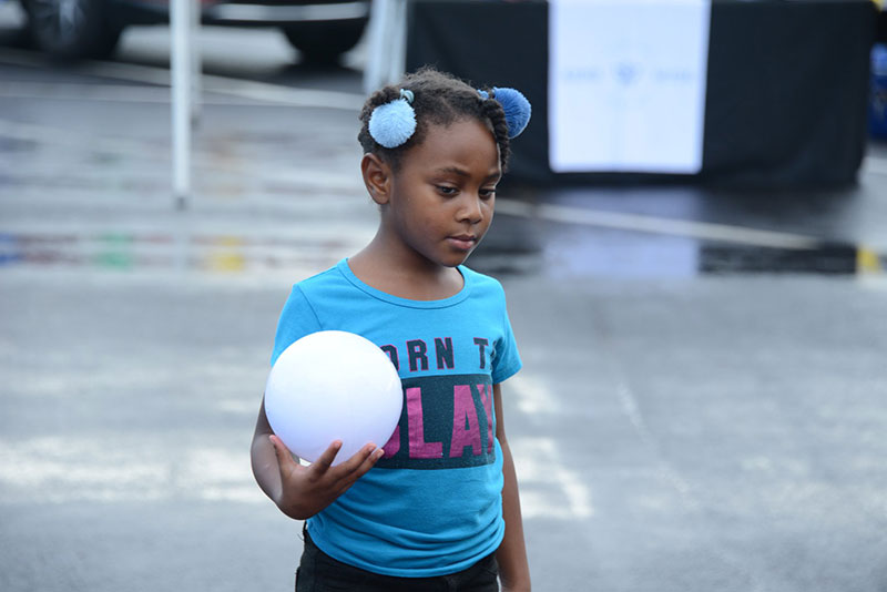 younggirlwithball.jpg